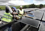 Engineers working on solar panel (h 250)
