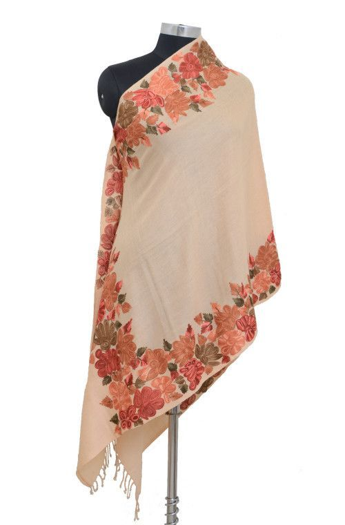An elegant pure pashmina shawl is  is completely hand embroidered with stunning aari work. The shawls/stoles are made from a blend of finest pashmina (cashmere) wool & silk, exclusively hand spun and hand woven by craftsmen in Kashmir.